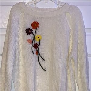 Embroidered sweater with cut outs